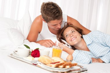 Young smiling couple having luxury breakfast