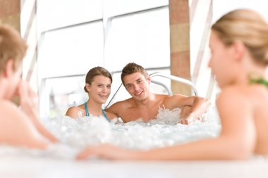 Swimming pool - happy couple relax in hot tub
