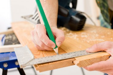 Home improvement - handyman prepare wooden floor