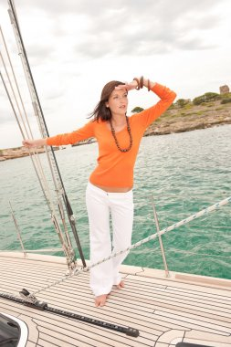 Attractive woman sailing on luxury yacht
