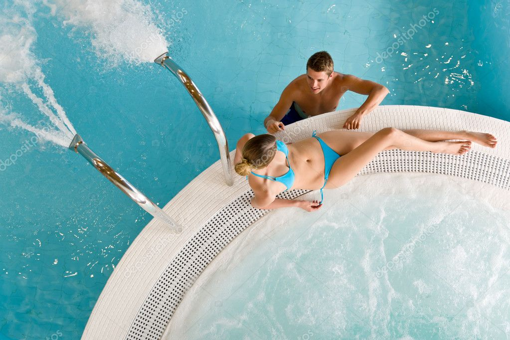 Top view - young couple relax in swimming pool