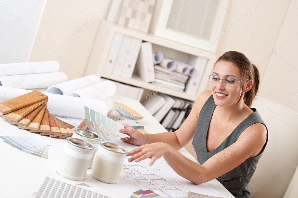 female interior designer showing -#main