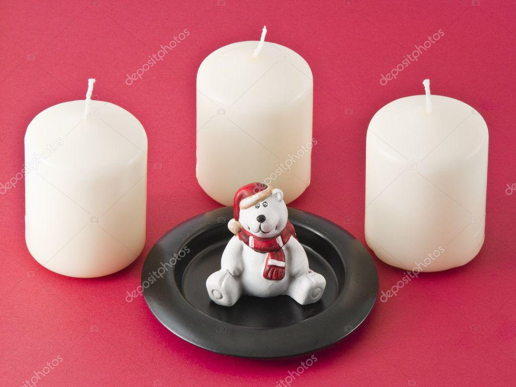 Candles and a teddy bear figurine