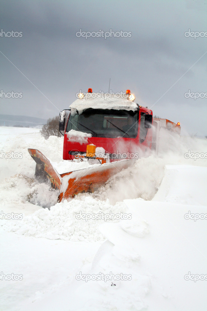 Snowplow in winter snow storm