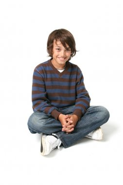 Child boy sitting isolated