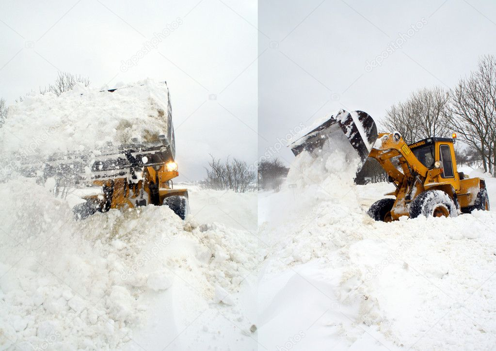 Digger in winter snow storm