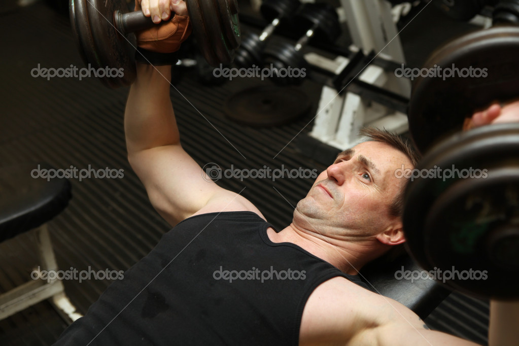 Training triceps weights dumbell — Stock Photo © tlorna #4574056