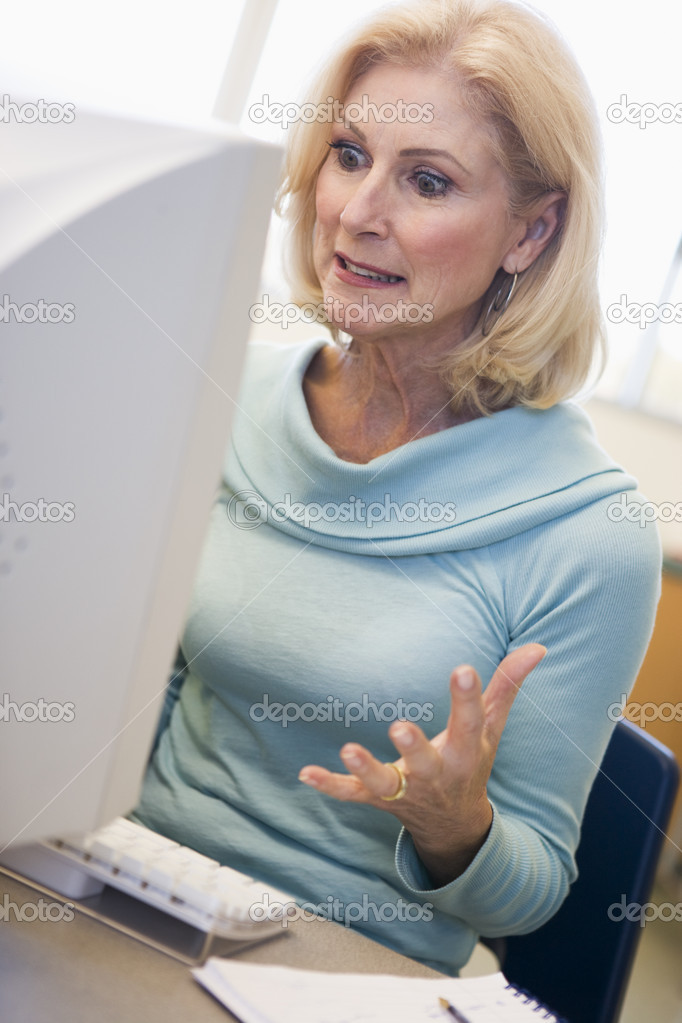 Mature Female Student Expressing Frustration At Computer -1314
