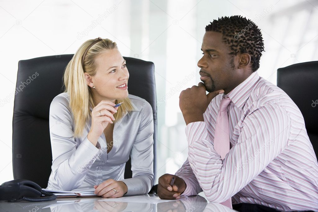 Two businesspeople in office talking — Stock Photo ...