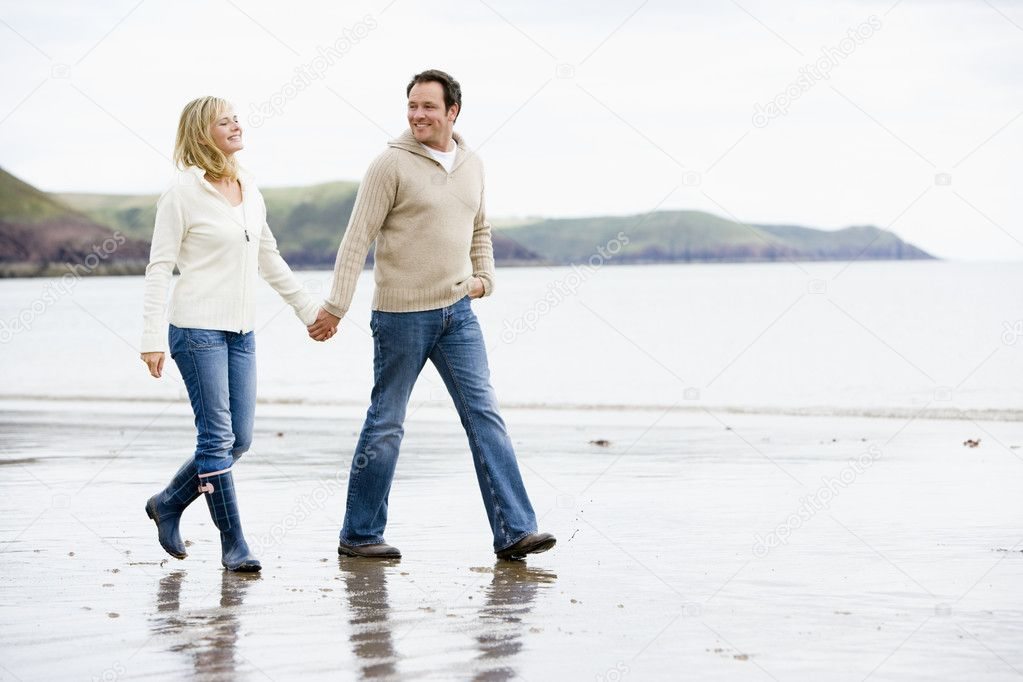 People Holding Hands Walking