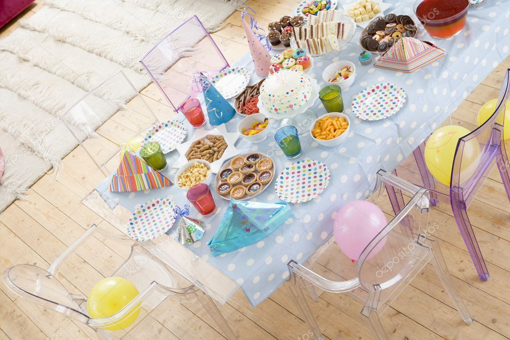 Birthday party table setting with food Stock Photo