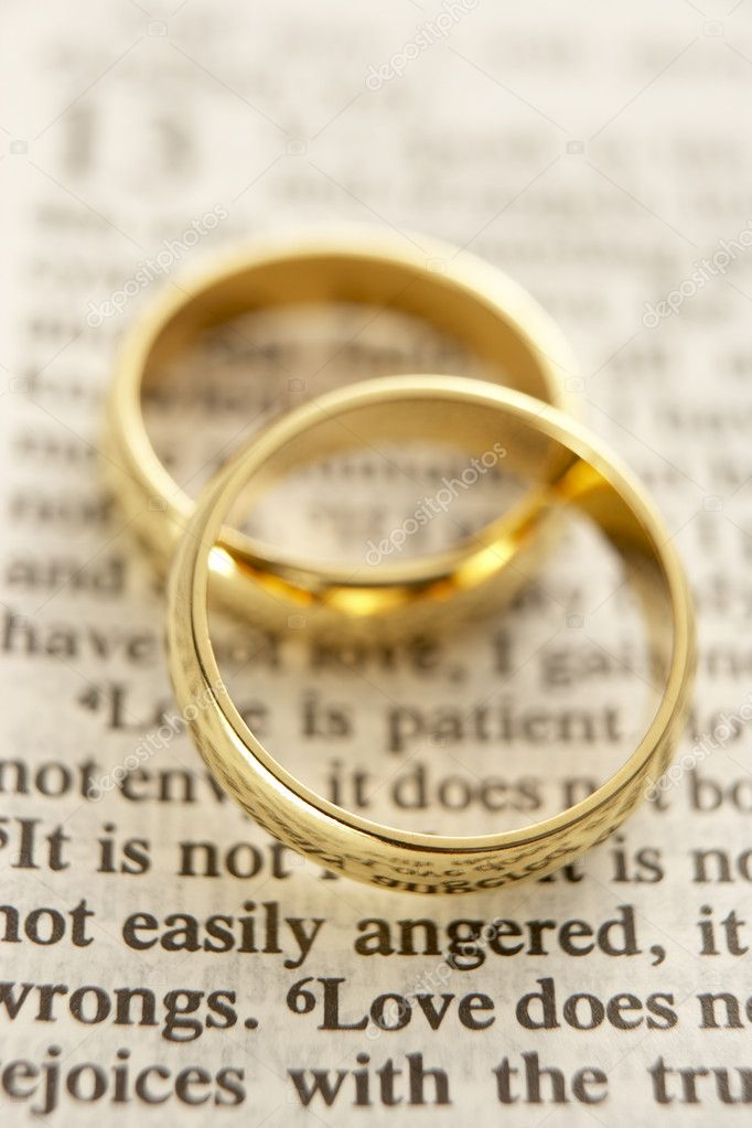 Two Wedding Rings Resting On A Bible Page Stock Photo 4789783