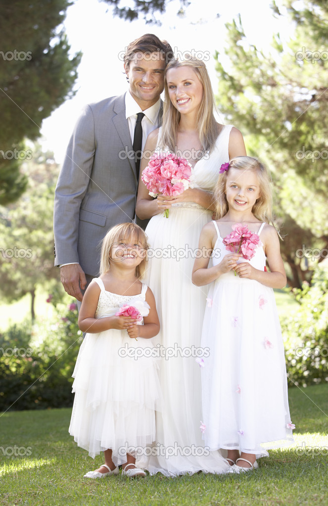 Bride And Groom With Bridesmaid At Wedding Stock Photo