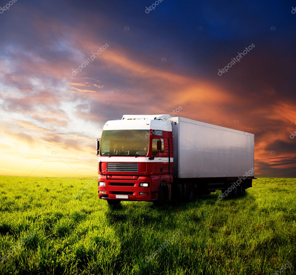 Field of grass and truck
