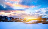 Fotografia tramonto e inverno Nord lago