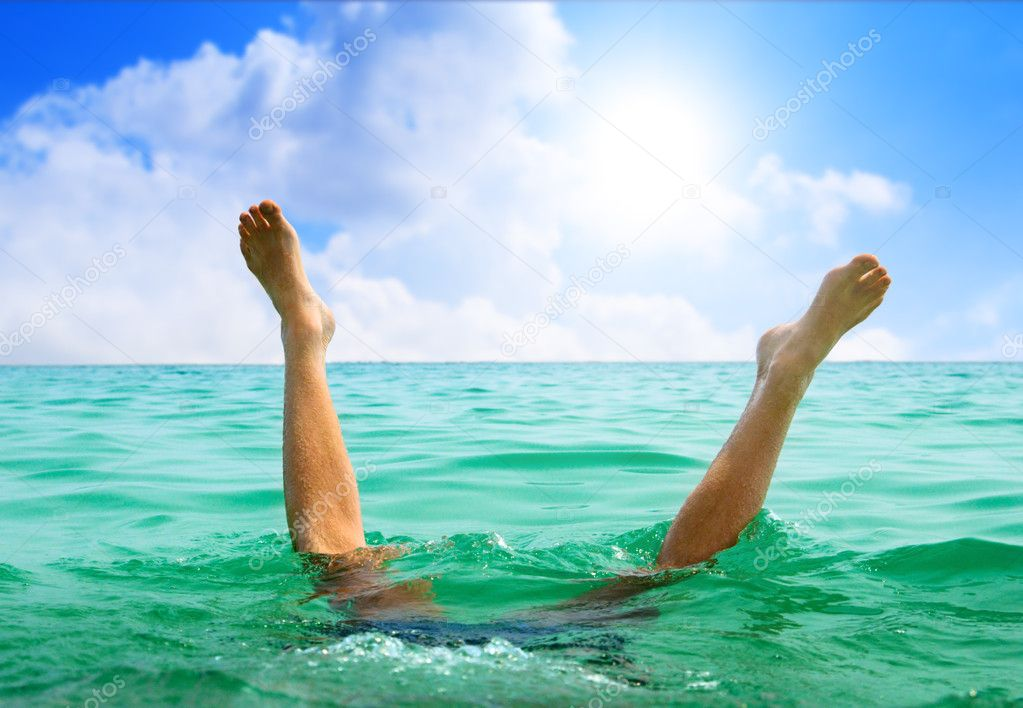 Man jumping in ocean