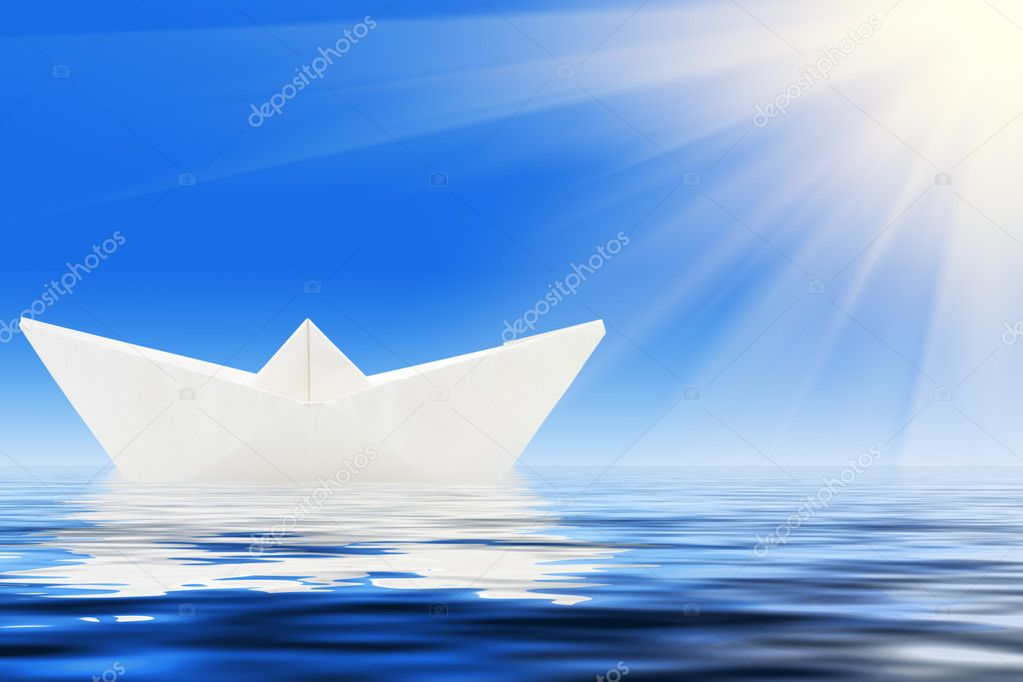Paper ship and blue water