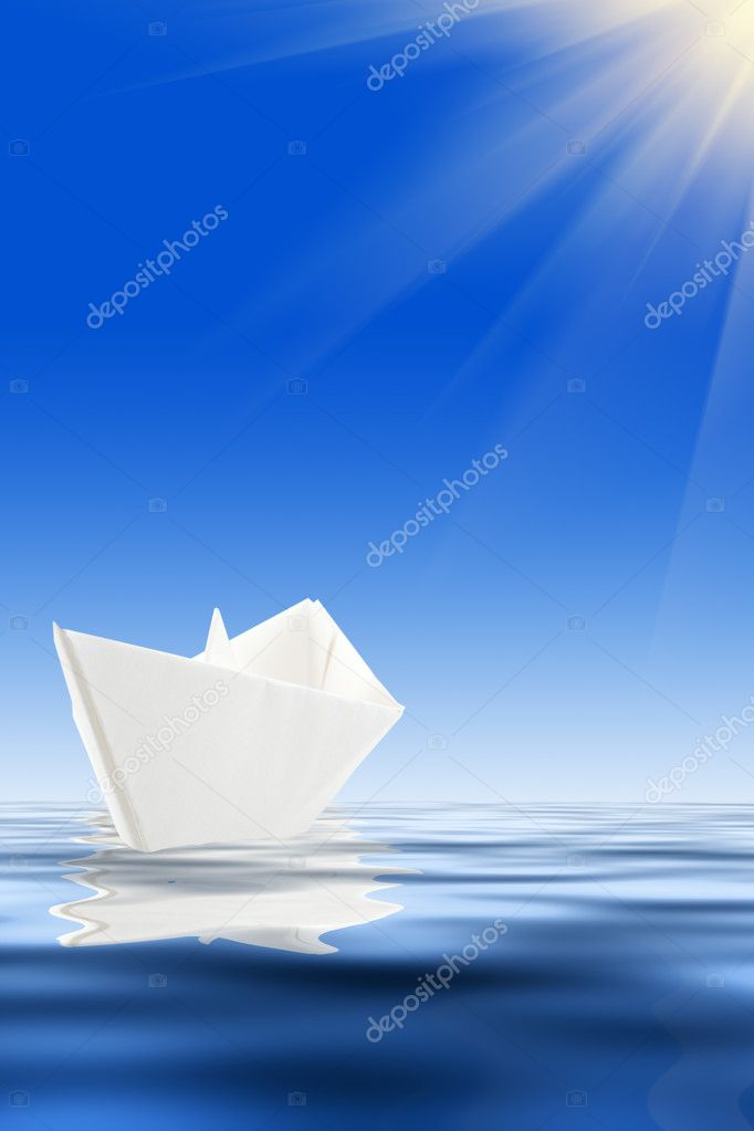Paper boat and blue water