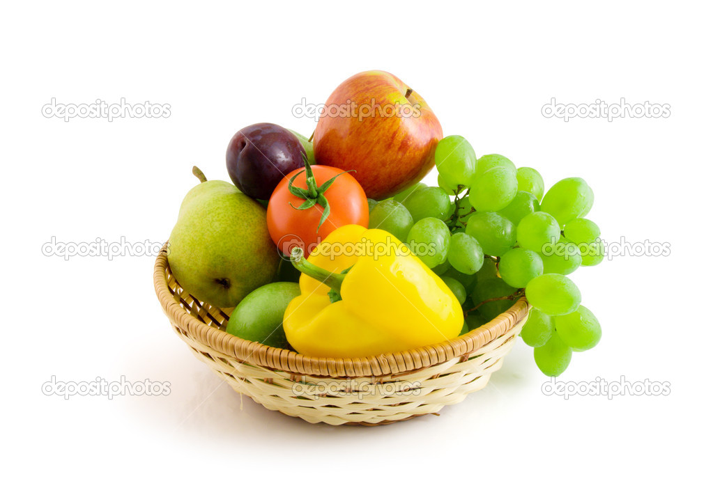 Fruits and vegetables in basket isolated on the white