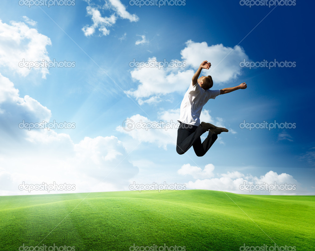 Jumping happy young man