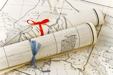 Old Maps in rolls with colorful ribbons