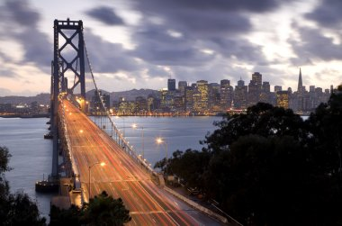 Time exposure image of traffic on the Bay Bridge from Treasure Island with San Francisco in the backgroung at sunset.