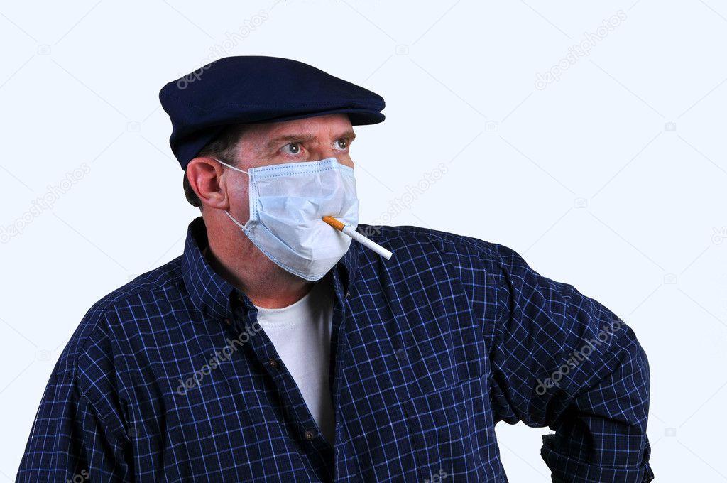 Smoking with a mask on — Stock Photo © amasterimage #4981234