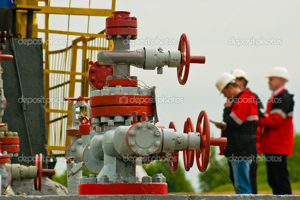 Three industry worker face oil pump
