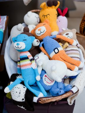 Stuffed animal toys in a basket