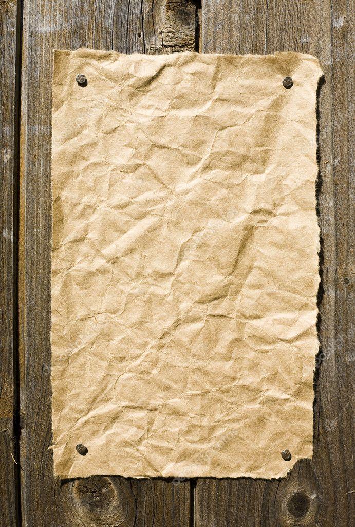 Old Paper On Dark Wooden Texture
