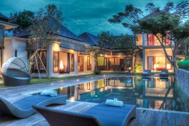 Luxury tropical villa and garden with swimming pool