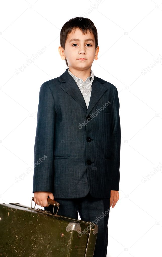 Boy in a suit and carrying a suitcase
