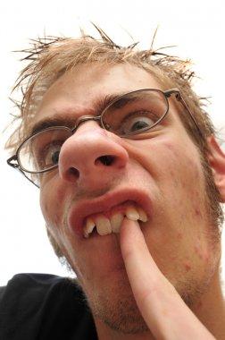 Ugly man picking his crooked teeth