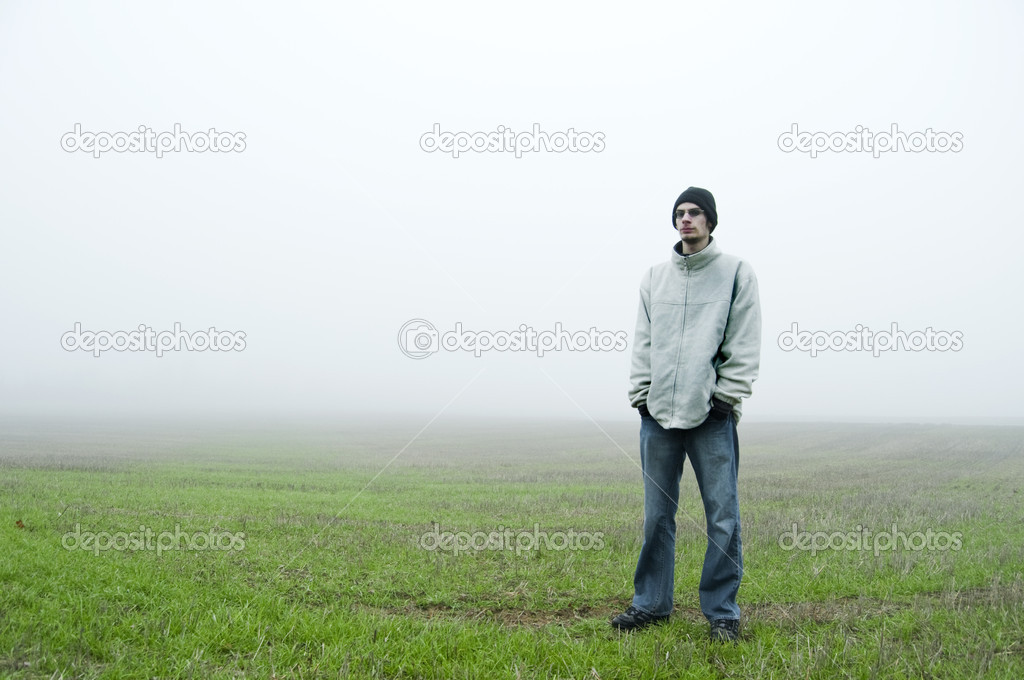 Teenager standing in field