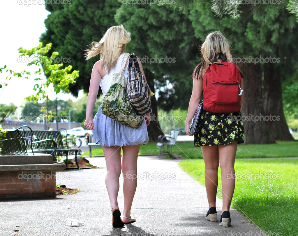 Students walking in front of school