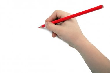 Child hand draws a red pencil
