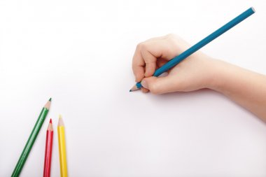 Child hand draws a blue pencil