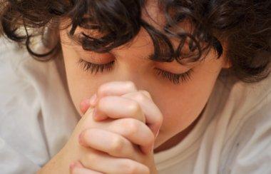 Latin Boy Praying