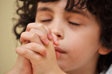 Hispanic Young Boy Praying with Faith and Reverence