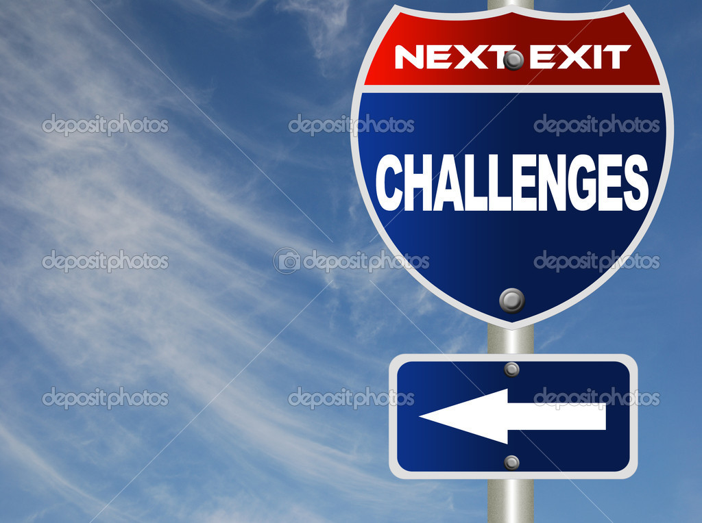 Challenges road sign with blue sky