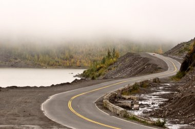 Curving road and low clouds in British Columbia