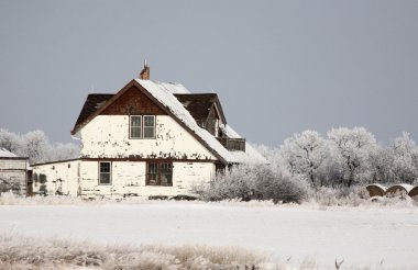Abandoned old farmhouse in winter