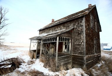 Abandoned old farm house in winter