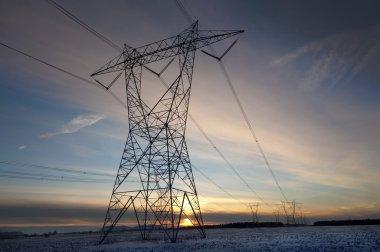 High volatge pylone at sunset in winter