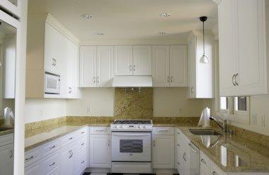 Interior of kitchen with granite countertop