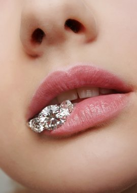 Beautiful female lips closeup with luxury diamonds in it