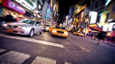 Blurred image of yellow taxi cab
