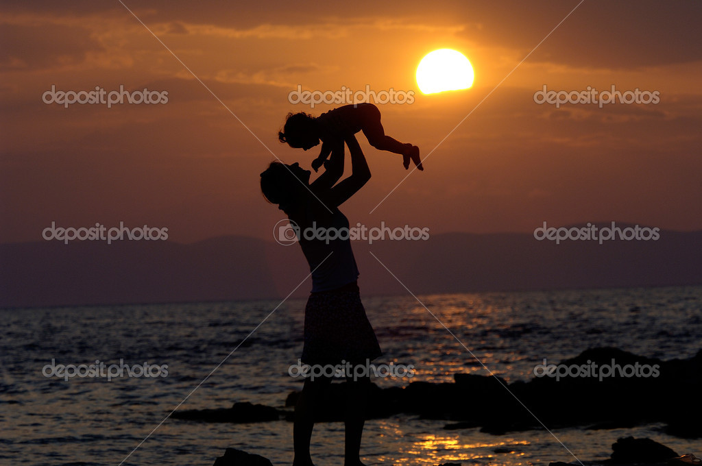 Mother With Kid In The Sunset