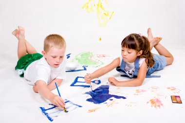 Two children painting.