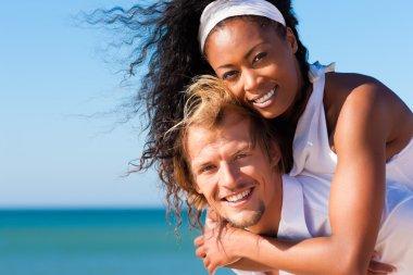 Couple in love - bikini-clad
